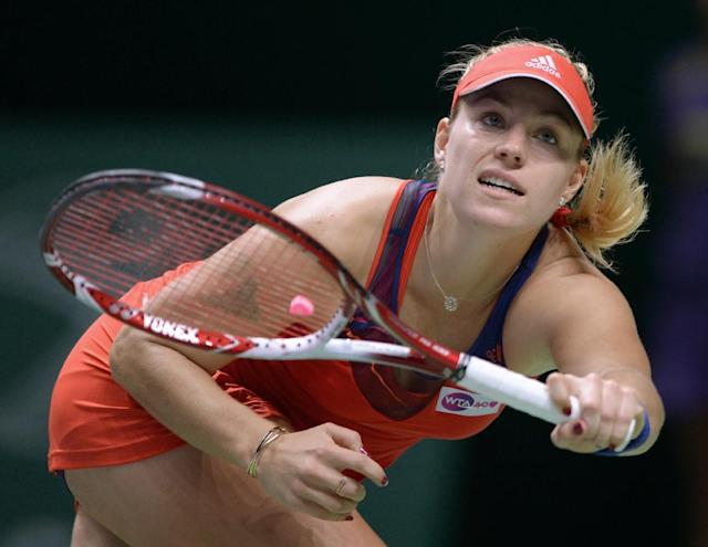 Angelique Kerber of Germany returns a shot to Petra Kvitova of Czech Republic during their tennis match at the WTA Championship in Istanbul, Turkey, Friday, Oct. 25, 2013. The world's top female tennis players compete in the championships which runs from Oct. 22 until Oct. 27.(AP Photo)