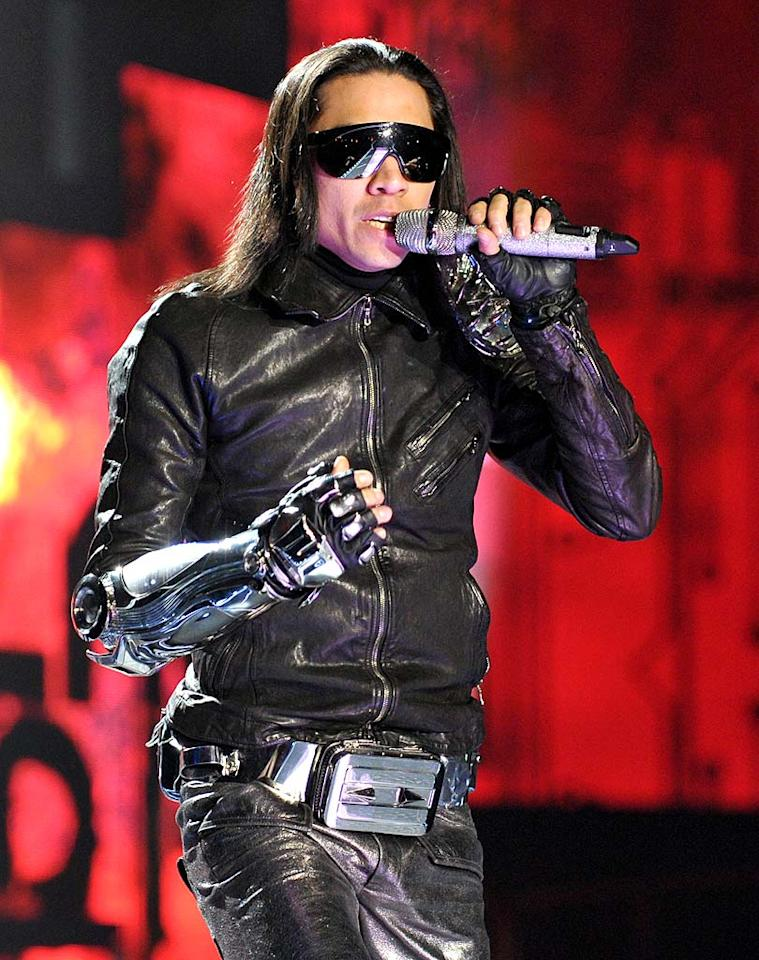 "The Peas occasionally perform dangerous stunts as well. During the show, Taboo rode through the air on a space-age motorcycle suspended from the ceiling. John Shearer/<a href=""http://www.wireimage.com"" target=""new"">WireImage.com</a> - March 29, 2010"