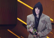 Justin Bieber accepts the award for artist of the year at the MTV Video Music Awards at Barclays Center on Sunday, Sept. 12, 2021, in New York. (Photo by Charles Sykes/Invision/AP)