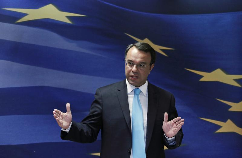 Greek Deputy Finance Minister Staikouras addresses reporters after a news conference in the Finance Ministry in Athens