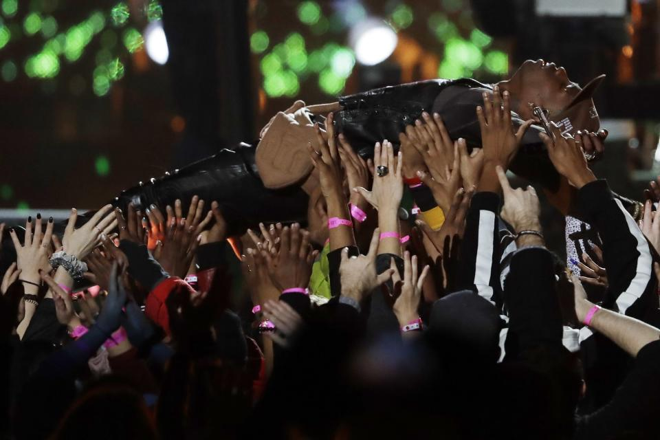 <p>Travis Scott is carried by the crowd during halftime show of the NFL Super Bowl 53 football game between the Los Angeles Rams and the New England Patriots Sunday, Feb. 3, 2019, in Atlanta. (AP Photo/Jeff Roberson) </p>