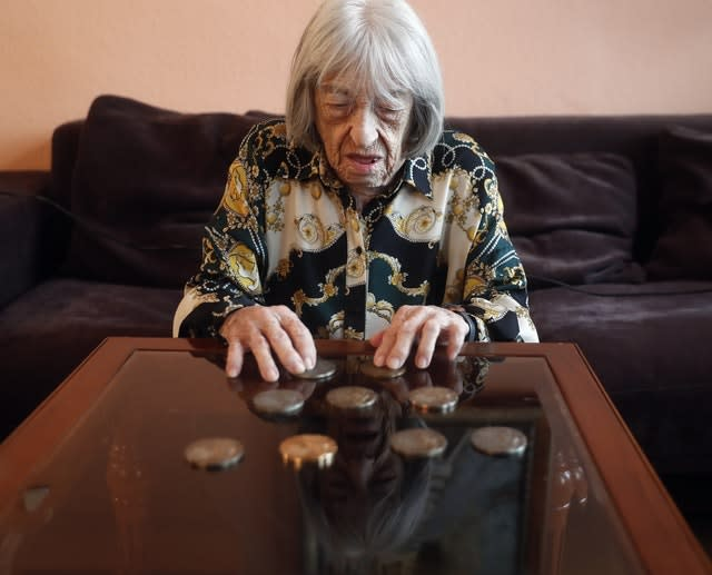 Agnes Keleti, former Olympic gold medal winning gymnast, looks at her medals at her apartment in Budapest, Hungary