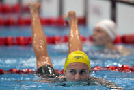 Ariarne Titmus of Australia leaves the pool following her women's 200-meter freestyle semifinal at the 2020 Summer Olympics, Tuesday, July 27, 2021, in Tokyo, Japan. (AP Photo/Martin Meissner)
