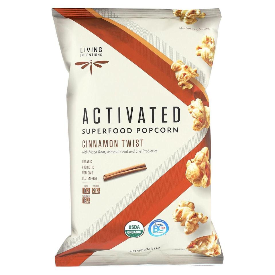 """<p><strong>Superfood Popcorn</strong></p><p>livingintentions.com</p><p><strong>$5.49</strong></p><p><a href=""""https://www.livingintentions.com/product/cinnamon-twist/"""" rel=""""nofollow noopener"""" target=""""_blank"""" data-ylk=""""slk:Shop Now"""" class=""""link rapid-noclick-resp"""">Shop Now</a></p><p>The golden popcorn you find at movie theaters may be a belt-stretching calorie-bomb, so healthier popcorn is a great sleep-inducing nighttime snack option. The carbohydrates in popcorn help transfer the amino acid tryptophan into your brain, where it's used to fire up the production of the sleep-inducing neurotransmitter serotonin. With a cinnamon-maple mix, this bagged option tastes like dessert—but with just 138 calories in a 3-cup serving.</p>"""