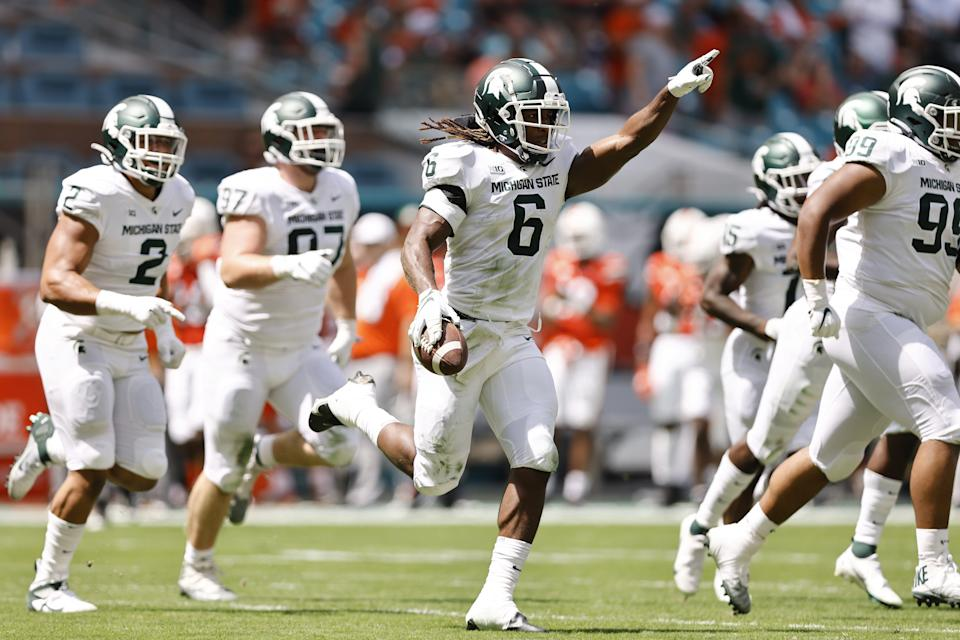 Michigan State linebacker Quavaris Crouch (6) celebrates after recovering a fumble during the first quarter of an NCAA college football game against Miami, Saturday, Sept. 18, 2021, in Miami Gardens, Fla. (AP Photo/Michael Reaves)