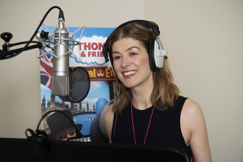 """Undated handout photo issued by Mattel of actress Rosamund Pike recording the new animated special """"Thomas & Friends: The Royal Engine"""", which features Thomas the Tank Engine meeting Queen Elizabeth II and a young Prince of Wales, along with new character the Duchess of Loughborough which is voiced by Ms Pike. The special episode has been produced as part of Thomas & Friends' 75th anniversary celebrations this year and includes a special on-camera introduction from the Duke of Sussex. PA Photo. Issue date: Tuesday April 28, 2020. The special episode will be screened in the US on Netflix on 01 May and in the UK on Channel 5 Milkshake! at 0800 on 02 May. See PA story ROYAL Thomas. Photo credit should read: Mattel, Inc/PA Wire NOTE TO EDITORS: This handout photo may only be used in for editorial reporting purposes for the contemporaneous illustration of events, things or the people in the image or facts mentioned in the caption. Reuse of the picture may require further permission from the copyright holder."""