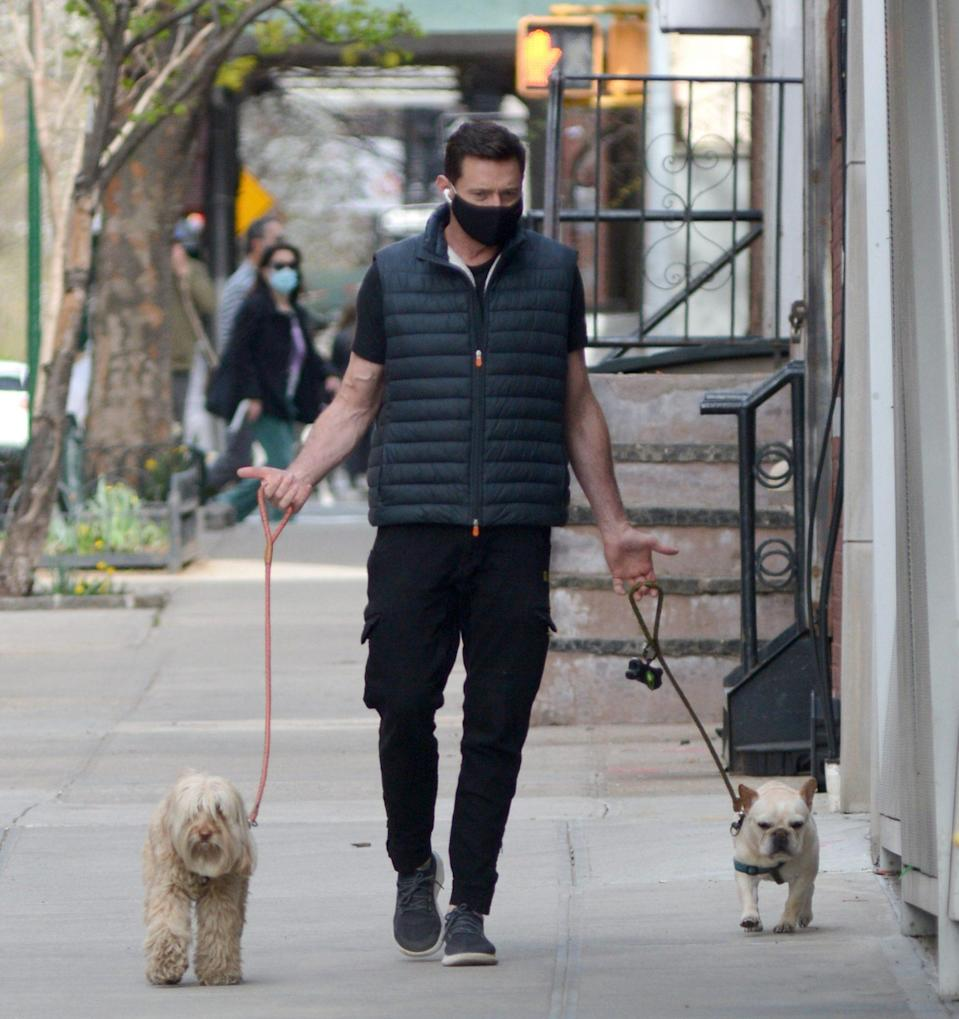<p>Hugh Jackman has his hands full during a Sunday stroll through N.Y.C.</p>