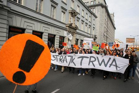 """People hold banners during a rally to support a nationwide teachers' strike in central Warsaw, Poland April 24, 2019. Banner reads """"The Strike Continues"""" Agencja Gazeta/Jedrzej Nowicki via REUTERS"""