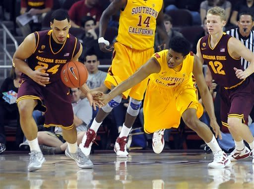 Arizona State guard Trent Lockett, left, grabs the loose ball away from Southern California guard Maurice Jones as Arizona State's Max Heller (12) looks on during the first half of an NCAA college basketball game, Thursday, Jan. 5, 2012, in Los Angeles. (AP Photo/Richard Hartog)