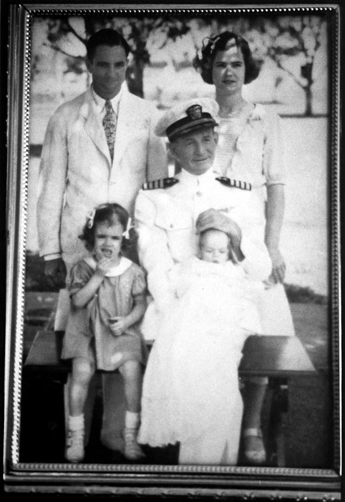 McCain as a baby on his grandfather's lap in a family portrait, circa 1936. Also pictured are his sister, father and mother.