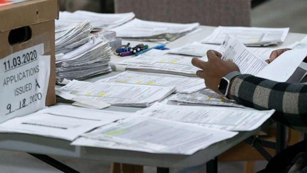 PHOTO: Election personnel sort absentee  ballot applications for storage at the Gwinnett County Board of Voter Registrations and Elections offices, Nov. 7, 2020, in Lawrenceville, Ga. (Elijah Nouvelage/Getty Images, FILE)