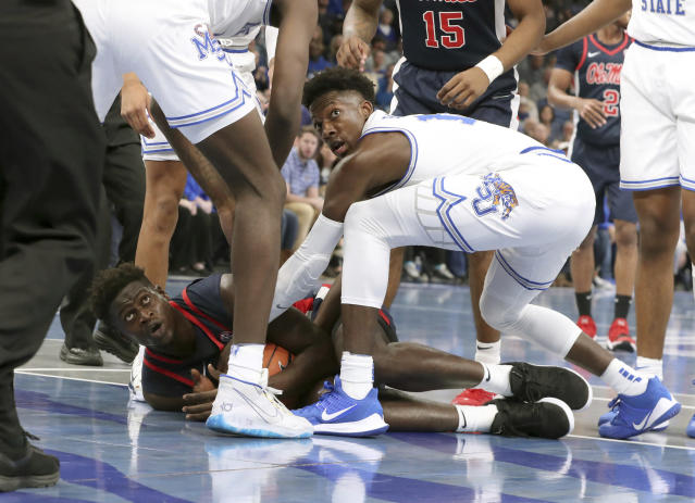 Memphis' Damion Baugh (10) and Mississippi Sammy Hunter (23) battle for the ball in the first half of an NCAA college basketball game Saturday, Nov. 23, 2019, in Memphis, Tenn. (AP Photo/Karen Pulfer Focht)