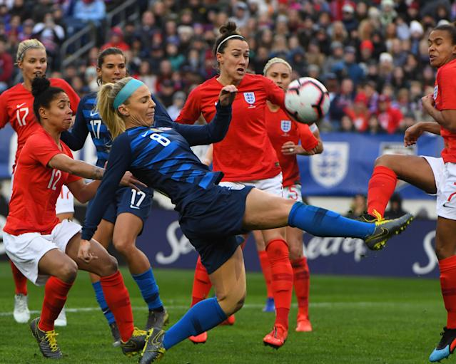 Julie Ertz (8) plays the ball amid a group of England players on Saturday during the SheBelieves Cup in Nashville, Tenn. (Reuters)