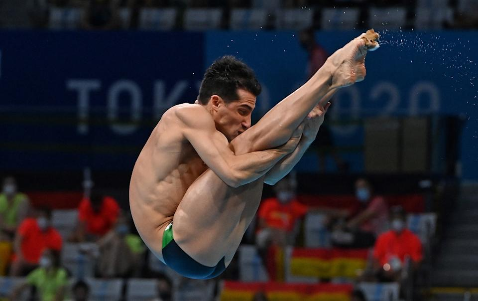 Mexico's Rommel Pacheco Marrufo competes in the preliminary round of the men's 3m springboard diving event during the Tokyo 2020 Olympic Games at the Tokyo Aquatics Centre in Tokyo on August 2, 2021. / AFP / Attila KISBENEDEK