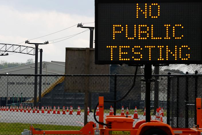 A sign is visible outside of Jim R. Miller Park during the first day of drive-thru coronavirus testing in Marietta, Georgia. (Photo: Kevin C. Cox via Getty Images)