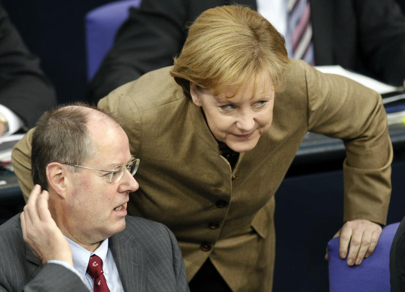 FILE - In this Nov. 25, 2008 file picture German Chancellor Angela Merkel talks to then German Finance Minister Peer Steinbrueck at the German Federal Parliament in Berlin, Germany. Merkel is challenged by Social Democratic front runner Steinbrueck as she runs for a third term in Germany's general election on Sunday, Sept. 22, 2013. (AP Photo/Michael Sohn, File)