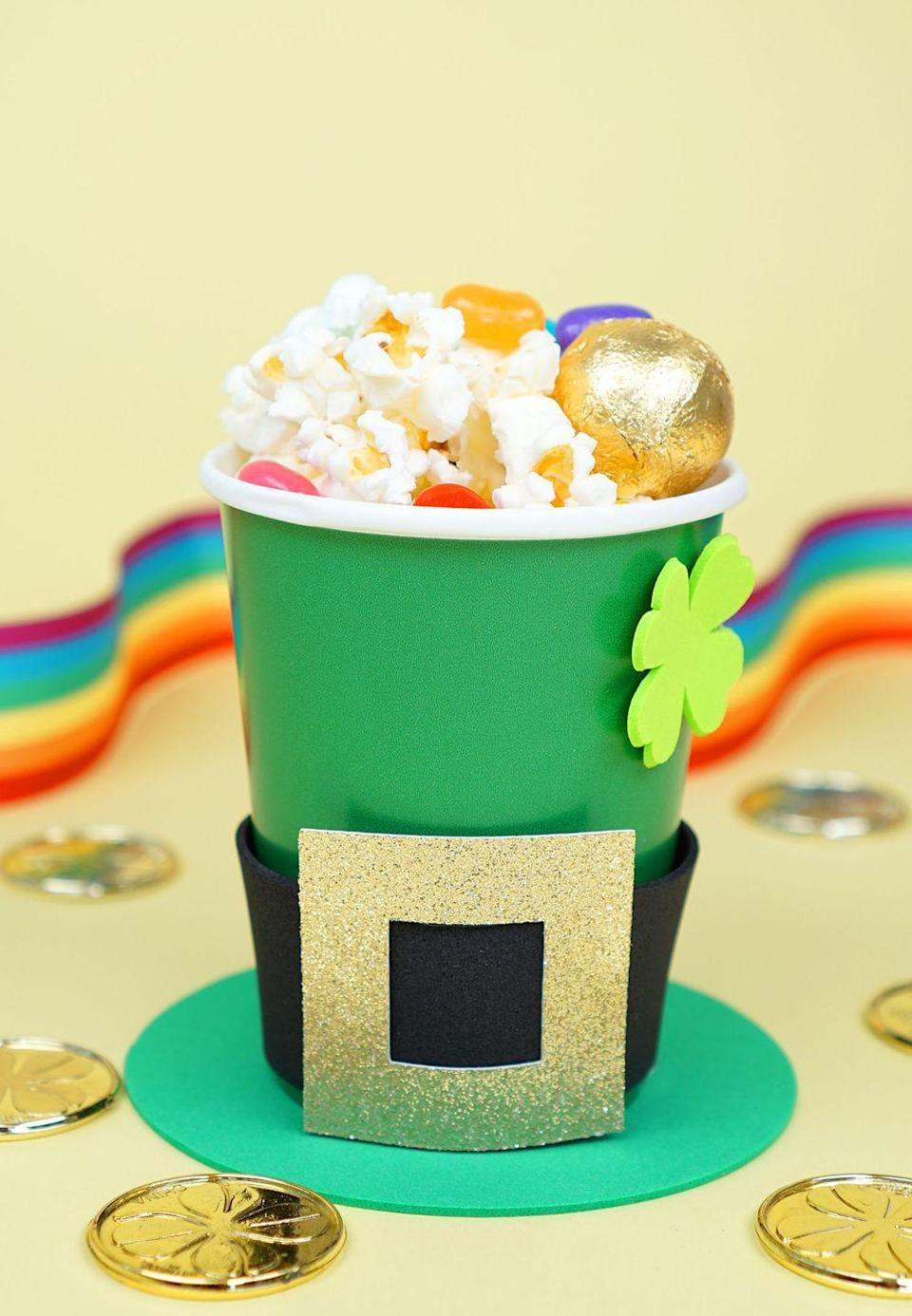 """<p>Put these cheerful Leprechaun hats together for your party guests to enjoy their snacks in.</p><p><strong>Get the tutorial at <a href=""""https://www.happinessishomemade.net/leprechaun-hat-st-patricks-day-treats/"""" rel=""""nofollow noopener"""" target=""""_blank"""" data-ylk=""""slk:Happiness Is Homemade"""" class=""""link rapid-noclick-resp"""">Happiness Is Homemade</a>.</strong></p><p><strong><a class=""""link rapid-noclick-resp"""" href=""""https://www.amazon.com/Adtech-Mini-Temp-Glue-Combo/dp/B00URCP4PC/?tag=syn-yahoo-20&ascsubtag=%5Bartid%7C10050.g.4036%5Bsrc%7Cyahoo-us"""" rel=""""nofollow noopener"""" target=""""_blank"""" data-ylk=""""slk:SHOP HOT GLUE GUNS"""">SHOP HOT GLUE GUNS</a><br></strong></p>"""