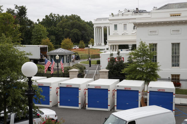 <p>Storage containers line the driveway as the West Wing of the White House in Washington goes through renovations while President Donald Trump is spending time at his golf resort in New Jersey, Friday, Aug. 11, 2017. (AP Photo/J. Scott Applewhite) </p>