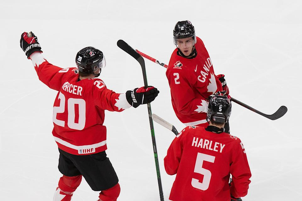EDMONTON, AB - JANUARY 04: Dawson Mercer #20, Braden Schneider #2 and Thomas Harley #5 of Canada celebrate a goal against Russia during the 2021 IIHF World Junior Championship semifinals at Rogers Place on January 4, 2021 in Edmonton, Canada. (Photo by Codie McLachlan/Getty Images)