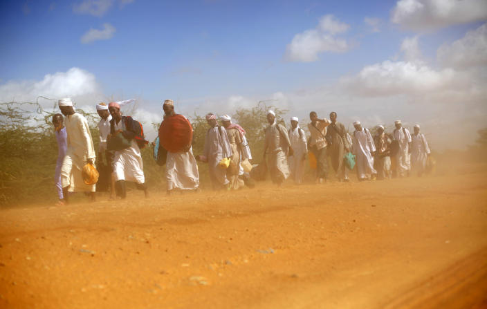 Muslim clerics walk in the dust on the dirt road outside Dadaab, eastern Kenya, 100 kms (60 miles) from the Somali border, Sunday Aug. 7, 2011. The drought and famine in the horn of Africa has killed more than 29,000 children under the age of 5 years in the last 90 days in southern Somalia alone, according to U.S. estimates. The U.N. says 640,000 Somali children are acutely malnourished, suggesting the death toll of small children will rise. (AP Photo/Jerome Delay)