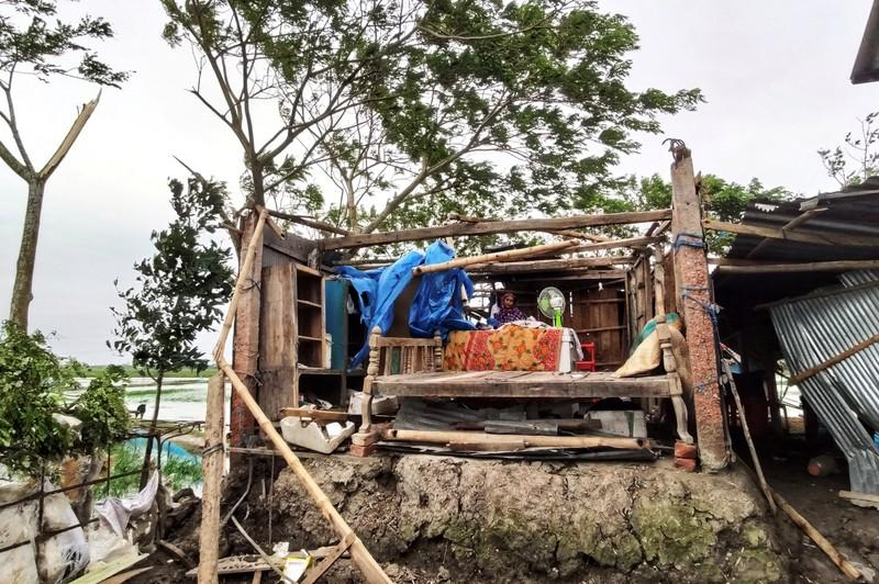 Woman is seen inside her damaged house after cyclone Bulbul hit the area in Khulna