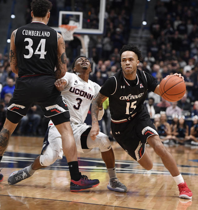 Connecticut's Alterique Gilbert (3) is stopped by the defense of Cincinnati's Jarron Cumberland (34) as Cincinnati's Cane Broome (15) dribbles around him toward the basket during the second half of an NCAA college basketball game, Sunday, Feb. 24, 2019, in Hartford, Conn. (AP Photo/Jessica Hill)