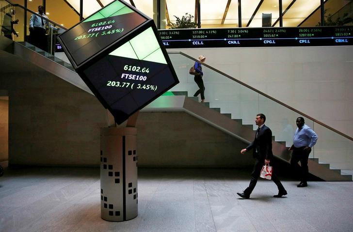 FILE PHOTO: People walk through the lobby of the London Stock Exchange in London