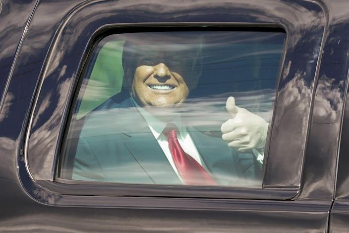 <p>The former POTUS gives a thumbs-up while driven from the airport to his new home.</p>