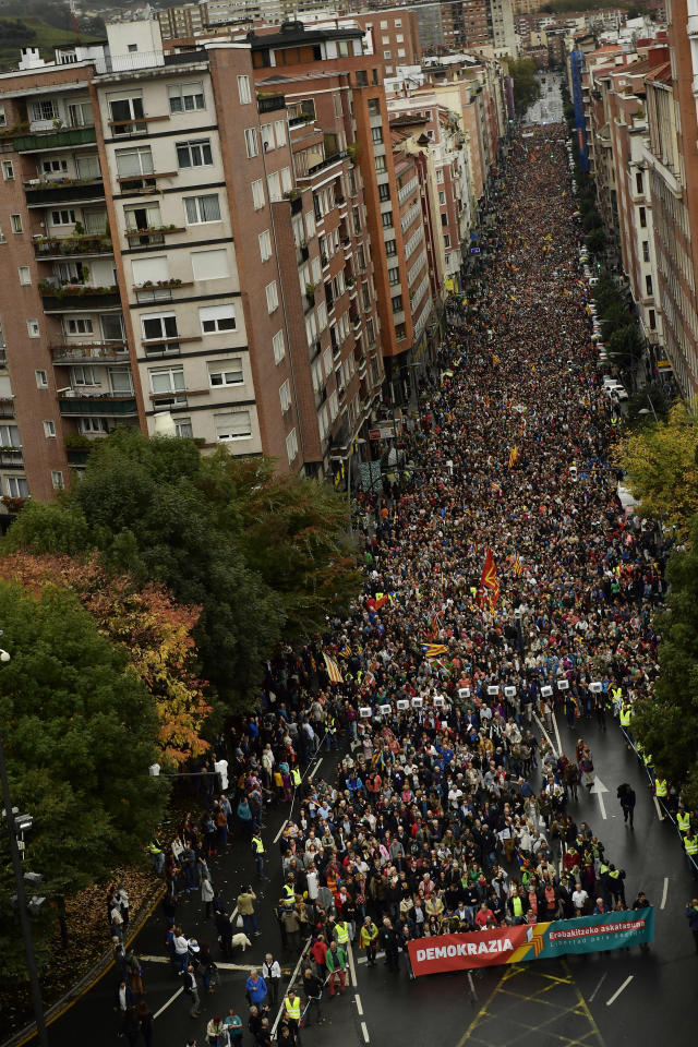 "<p>Thousands of pro-independence supporters march with a banner reading in Basque ""democracy"" during a rally in support of the Catalonia's secession referendum, in Bilbao, northern Spain, Saturday, Sept. 30, 2017. (Photo: Alvaro Barrientos/AP) </p>"