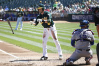 FILE PHOTO: Oakland Athletics shortstop Jed Lowrie tosses his bat after being walked in the first inning of his the MLB American League baseball game against the Texas Rangers in Oakland, California September 4, 2013. REUTERS/Stephen Lam