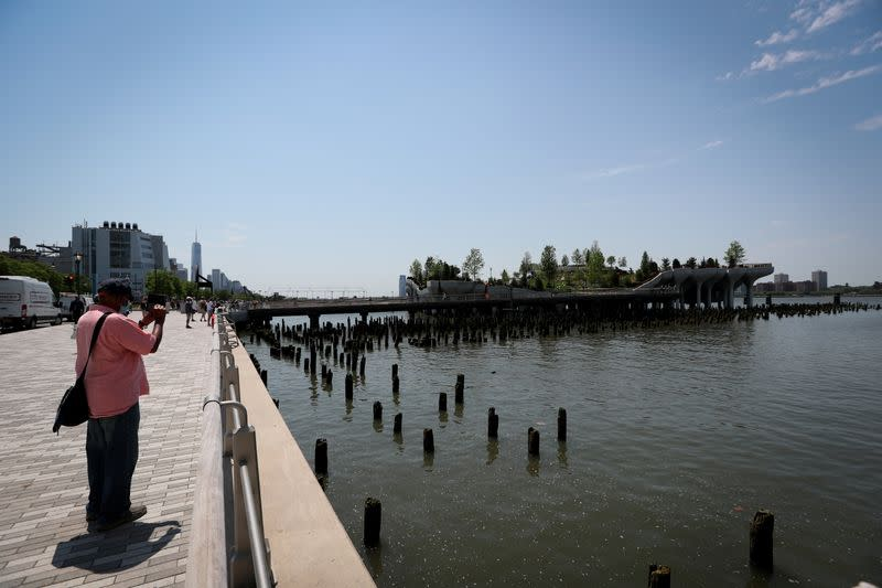 People visit Little Island Park, a new public park space which sits on stilts over the Hudson River during opening day in New York
