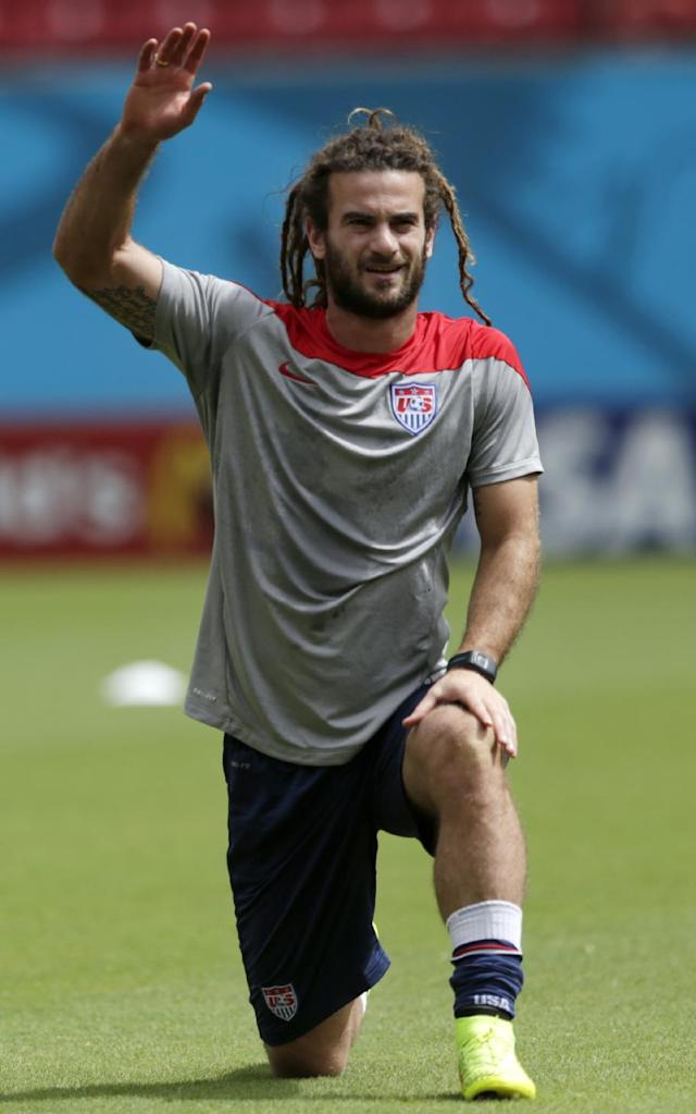 United States' Kyle Beckerman stretches during a training session in Recife, Brazil, Wednesday, June 25, 2014. The U.S. will play Germany in group G of the 2014 soccer World Cup on June 26. (AP Photo/Julio Cortez)