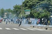Confrontation: Police used teargas to disperse supporters in Abidjan