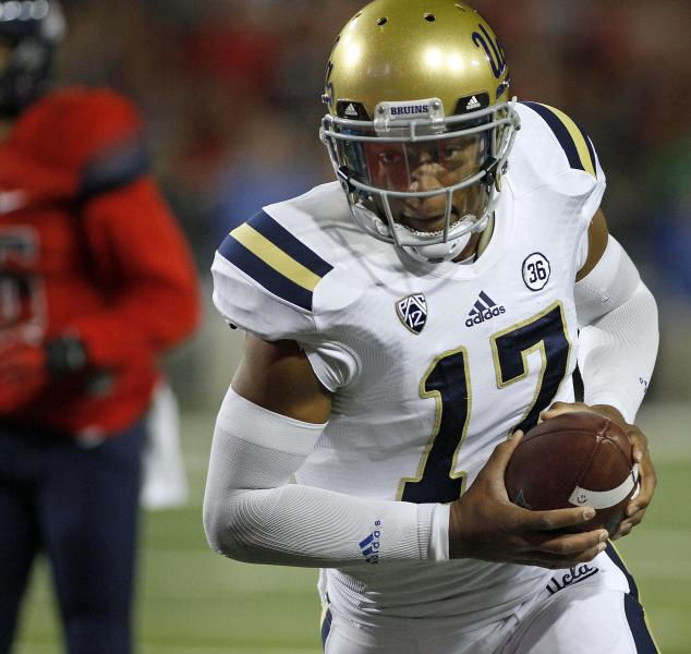 UCLA quarterback Brett Hundley looks into the end zone as he runs in for a touchdown against Arizona in the first half of an NCAA college football game Saturday, Nov. 9, 2013 in Tucson, Ariz. (AP Photo/John MIller)