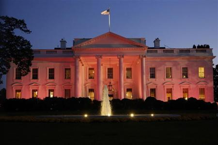 The White House is seen lit pink to observe Breast Cancer Awareness Month in Washington