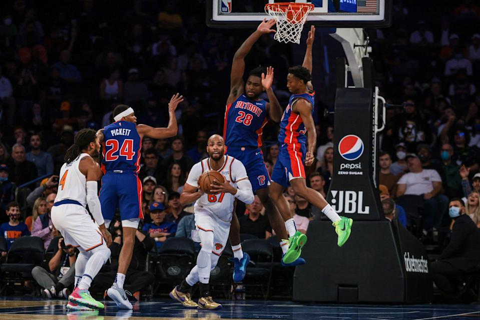 New York Knicks forward Taj Gibson passes the ball as Detroit Pistons center Isaiah Stewart and forward Jamorko Pickett  defend during the first half at Madison Square Garden.