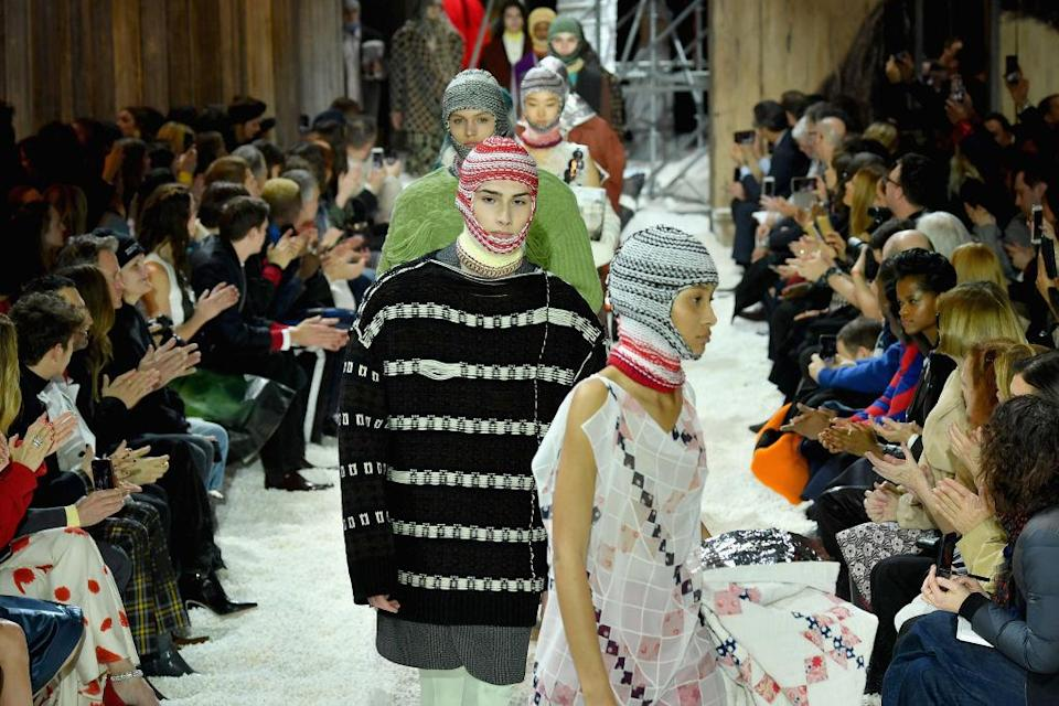 <p>Name a greater highlight than the realisation that fashion just got practical. Yes, over at Calvin Klein models took to the runway in some serious headgear and we're here for it. <em>[Photo: Getty]</em> </p>