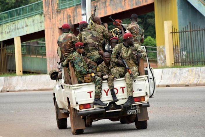 Residents of the capital Conakry's Kaloum district reported hearing heavy gunfire (AFP/CELLOU BINANI)