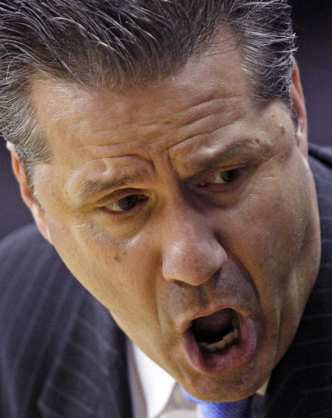 Kentucky head coach John Calipari talks with his team during the second half of a 71-64 loss to Vanderbilt in an NCAA college basketball game in the championship game of the 2012 Southeastern Conference tournament at the New Orleans Arena in New Orleans, Sunday, March 11, 2012. (AP Photo/Gerald Herbert)