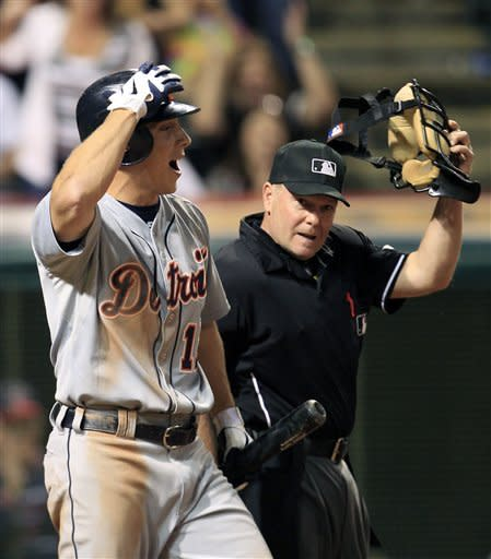 Detroit Tigers' Andy Dirks, left, argues a call with the home plate umpire Jerry Meals in the ninth inning in a baseball game against the Cleveland Indians, Wednesday, May 23, 2012, in Cleveland. Dirks struck out looking. The Indians won 4-2. (AP Photo/Tony Dejak)