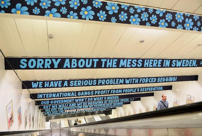 Banners reading 'Sorry about the mess here in Sweden' are seen at the metro station in Stockholm on August 3, 2015, where the Swedish Democrats launched a campaign against begging in English (AFP Photo/Berti Ericsson)