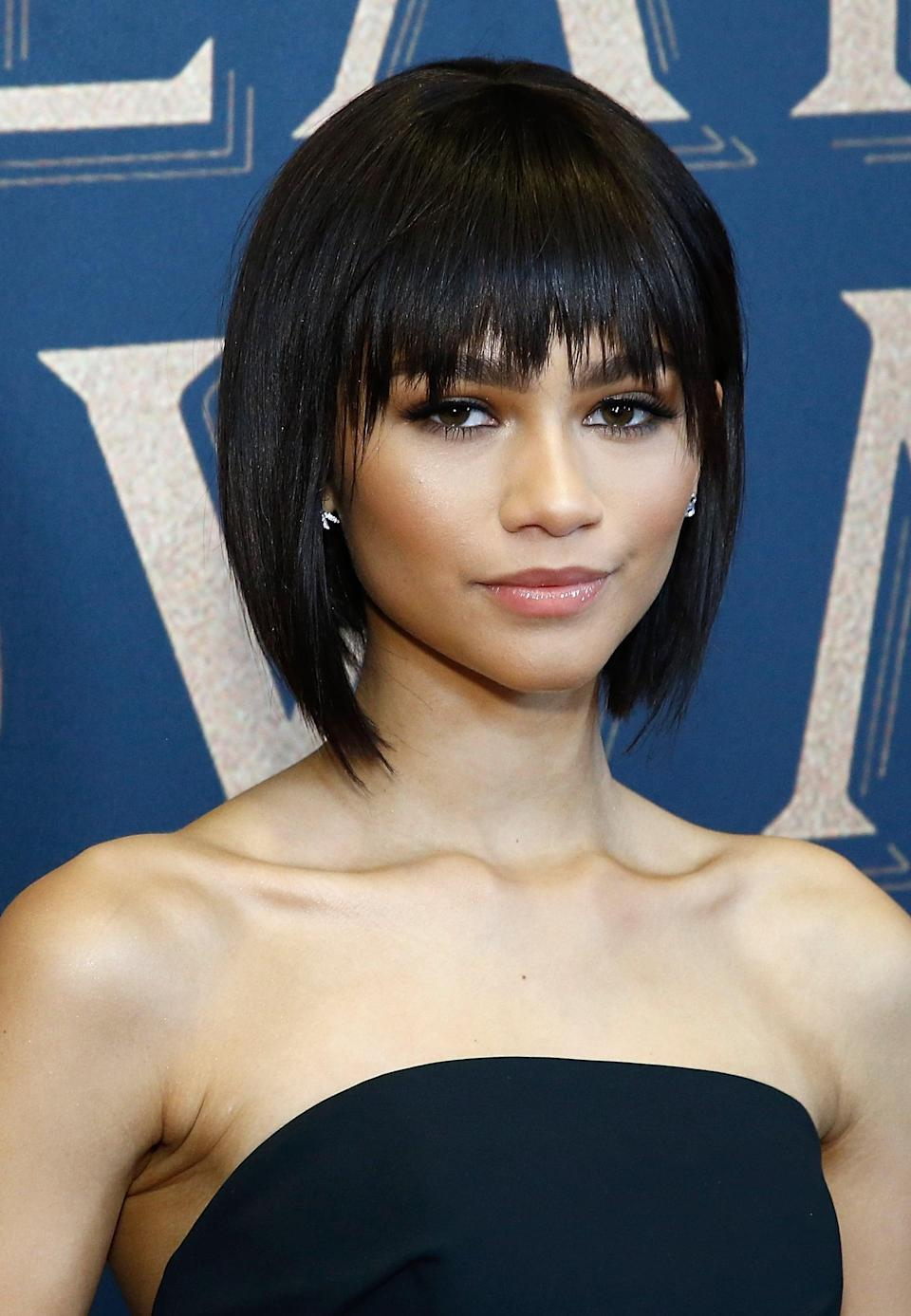 "<p><a class=""link rapid-noclick-resp"" href=""https://www.popsugar.com/Zendaya"" rel=""nofollow noopener"" target=""_blank"" data-ylk=""slk:Zendaya"">Zendaya</a> stepped out for the world premiere of <strong>The Greatest Showman</strong> in 2017 with a sleek, chin-length bob and long, choppy bangs. </p>"