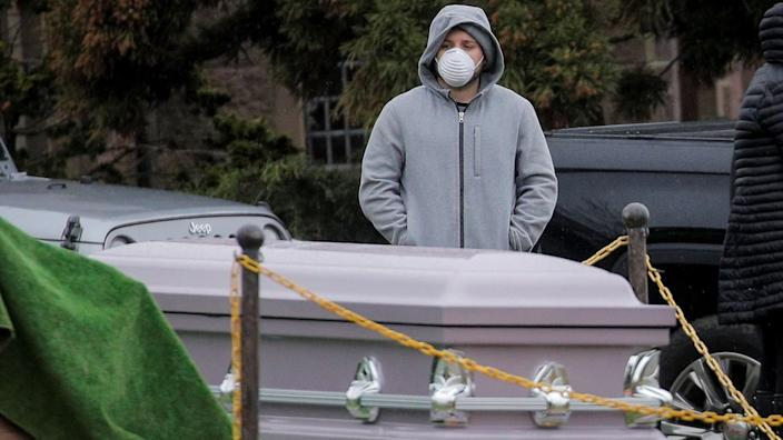 Mourners attend a funeral in Brooklyn, New York, as the city's coronavirus death toll hit a record high for a third day