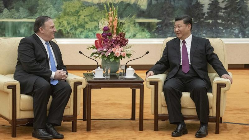 Mike Pompeo y Xi Jinping