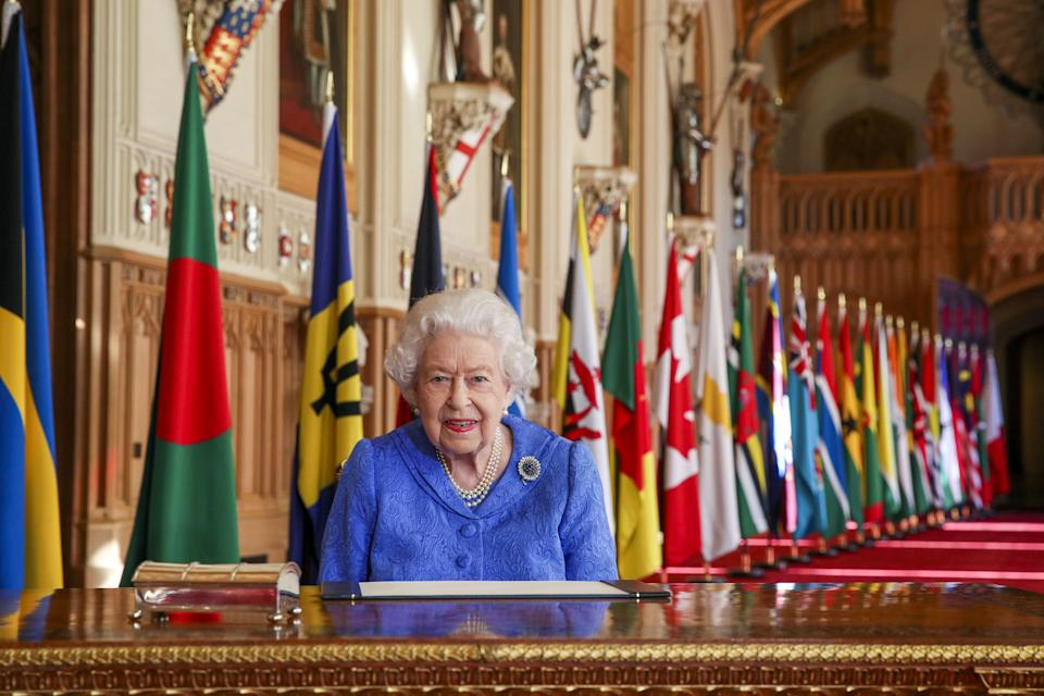 NOTE: RETRANSMITTED AMENDING EMBARGO FROM 2200HRS TO 1700HRS GMT SUNDAY MARCH 7 Embargoed to 1700hrs GMT Sunday March 7 2021 Queen Elizabeth II signs her annual Commonwealth Day Message in St George's Hall at Windsor Castle.