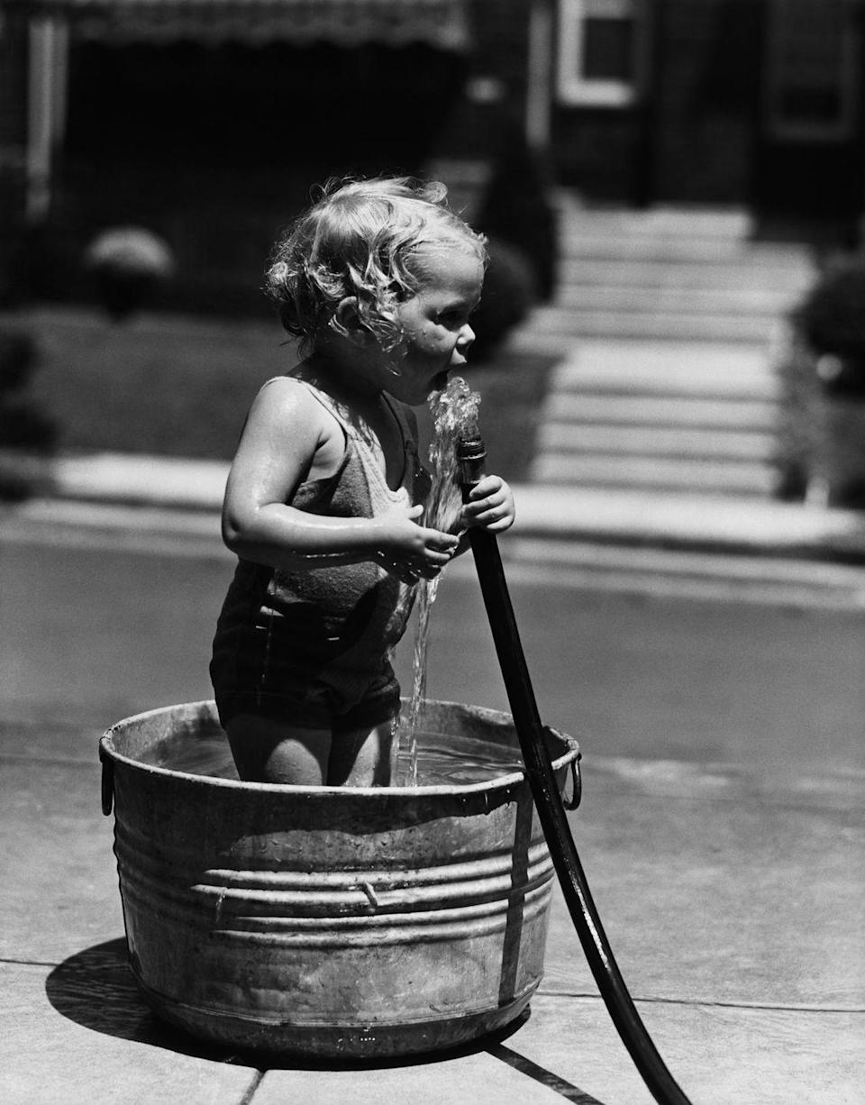 """<p> Bottled water wasn't even a thing in the '60s unless you had a canteen. The hose, yours or a neighbor's, was how children stayed hydrated while playing outside. Hoses were not regulated the way drinking water inside the home was, but no one ever dreamed that <a href=""""http://www.ecocenter.org/newsletter/2013-05/dont-drink-out-hose"""" rel=""""nofollow noopener"""" target=""""_blank"""" data-ylk=""""slk:unsafe levels of lead"""" class=""""link rapid-noclick-resp"""">unsafe levels of lead</a> were coming through. (Also, the brass nozzle was a danger because it could leach lead.) It was also common to drink from public water fountains, which were later determined to be <a href=""""https://well.blogs.nytimes.com/2015/09/04/what-diseases-can-you-get-from-a-water-fountain/"""" rel=""""nofollow noopener"""" target=""""_blank"""" data-ylk=""""slk:more of a health hazard."""" class=""""link rapid-noclick-resp"""">more of a health hazard.</a> </p>"""