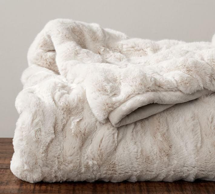 <p>While blankets come in a range of prices, investing in a thick, soft, and well-made blanket that will keep you warm and your sofa or bed stylish is worth it. This <span>Pottery Barn faux fur ruched throw</span> ($143, originally $179) is a dream to snuggle with and adds a luxe Winter vibe to any room. If you're looking for something classic that will keep out the harshest cold, go for this ultrathick and superwarm <span>pure virgin wool blanket</span> ($206, originally 229) from Brooklinen. Handmade in Germany by a 100-year-old family mill, it's the kind of blanket you'll have for generations.</p>