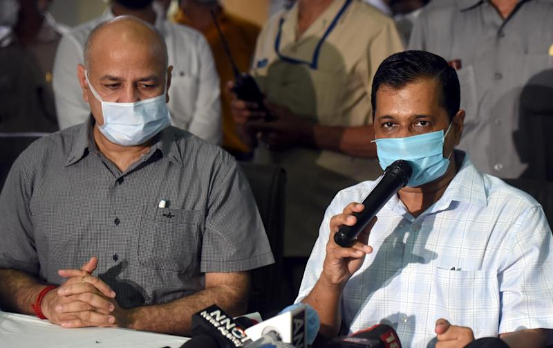 Delhi Chief Minister Arvind Kejriwal and Deputy CM Manish Sisodia address the media during a visit to the Rajiv Gandhi Super Specialty Hospital at Dilshad Garden on July 6, 2020 in New Delhi. (Photo: Hindustan Times via Getty Images)