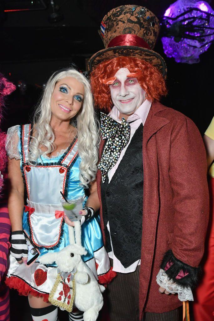 <p>Stylist to the stars Jennifer Mazur and celeb photographer Kevin Mazur attended Heidi Klum's annual H-ween bash in 2018 as Alice in Wonderland and the Mad Hatter. Jennifer even brought a white rabbit (stuffed, of course). Love!</p>