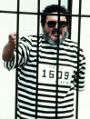 FILE - In this Sept. 1992 file photo, Abimael Guzman, the founder and leader of the Shining Path guerrilla movement, shouts inside of a jail cell after being captured in Lima, Peru. The Peruvian government reported Saturday, Sept. 11, 2021, that Guzman died after an illness. (AP File Photo)